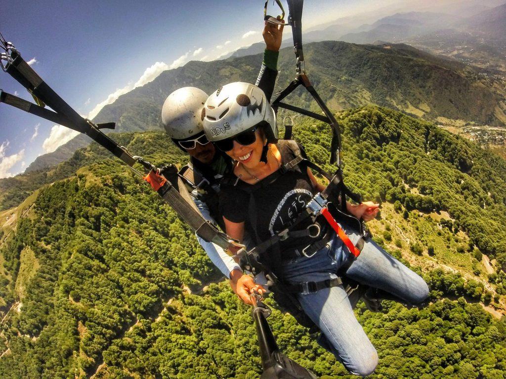 Anna from Global Gallivanting paragliding in Bir Billing, Himachal Pradesh, North India