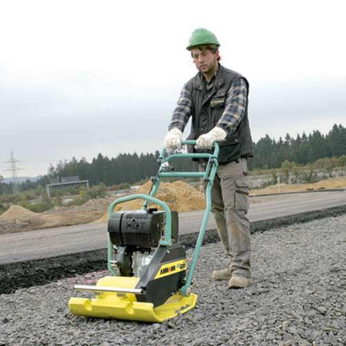 Picture showing an Ammann Forward Plate being operated on a tarmac road.