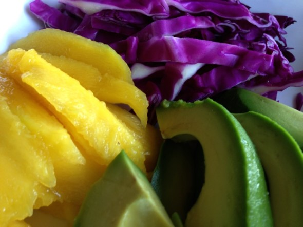 Slice the mango, avocado and purple cabbage.