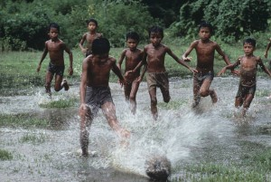 Happiness is barefoot football on the grass in the rain...  Pic courtesy: Steve McCurry