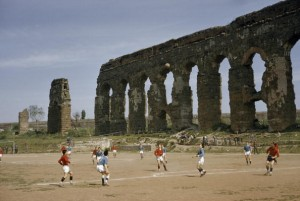 Boys playing in Rome near an ancient structure. 1957