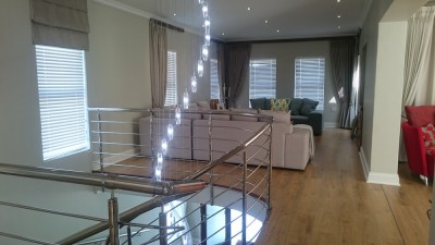 Fitted downlights, chandelier and laminated flooring