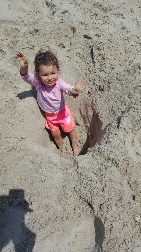 Raising arms high while in a sand hole