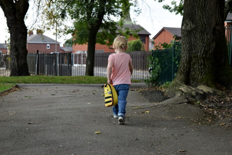 Little girl walking to playgroup