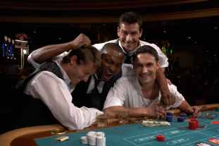 group of guys happy playing blackjack
