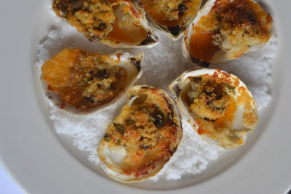 These amazing roasted oysters with smoked chilli butter and manchego cheese will be but one of many mouth-watering dishes at the re-born Brennan's (photo courtsey of Brennan's)