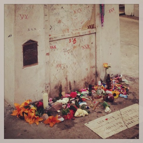 "Offerings at the tomb of ""Voodoo Queen"" Marie Laveau. Photo courtesy of @pollywoggs on Instagram."