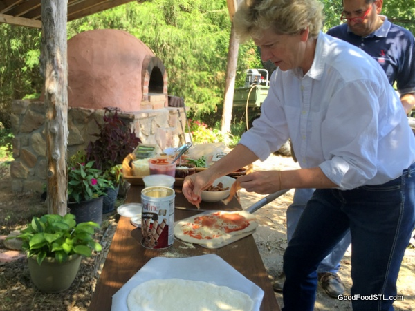 Preparing pizzas for cob oven