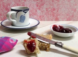Cherry apricot jam with tea