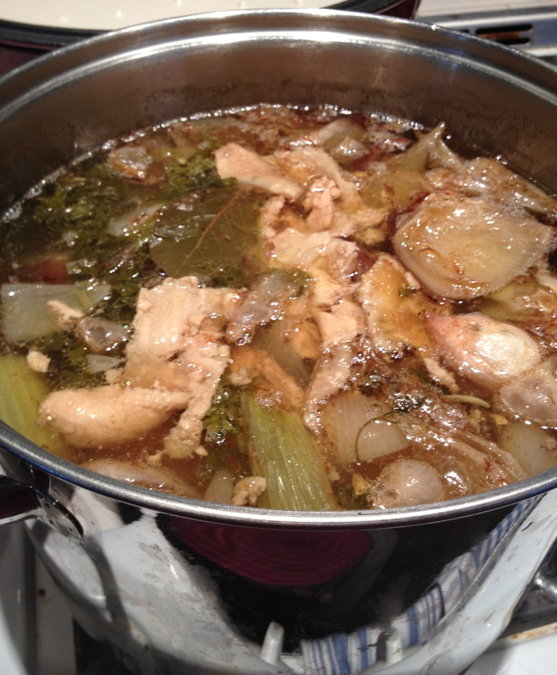 stock chicken cooking in pot