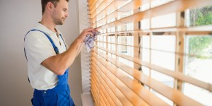bigstock-Handyman-cleaning-blinds-with--77909684