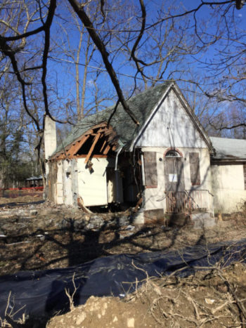On April 5th Prestige Building Company razed an abandoned building on the Library's site in Salesian Park.