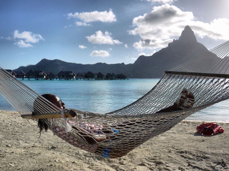 Nat Relaxing in a Hammock on a Private Beach in Bora Bora