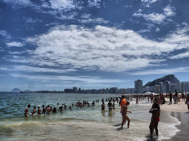 Sunseekers Cooling Down in the Sea on Copacabana Beach