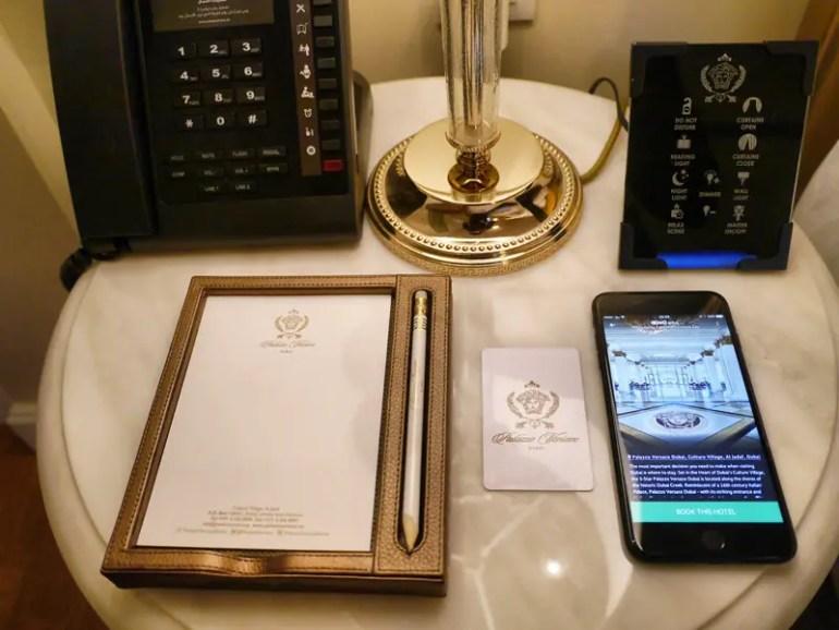 A Designer Bedside Table: Versace Pencil, Paper Pad, Room Key, Lamp and Room Controls