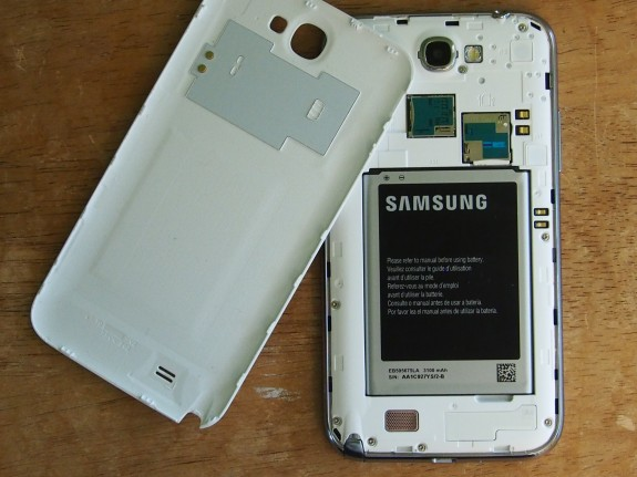 The Samsung Galaxy Note 2 comes with a removable back. The Droid RAZR MAXX HD does not.