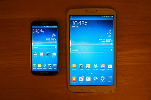 Galaxy S4 with 5-inch 1080p HD display next to the Galaxy Tab 3 8.0