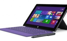 The Surface Pro 2 with purple Type Cover 2 accessory.
