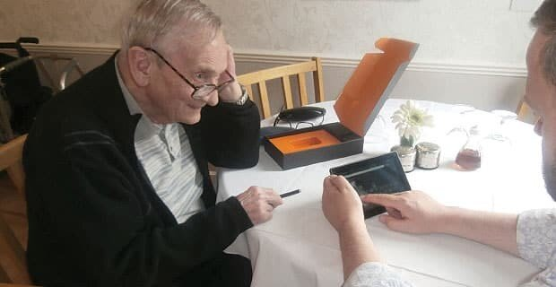 Older person with computer