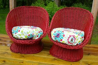 Outdoor furniture makeover with red paint, two old wicker chairs get a bold new look with red paint and covered cushions.