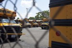 Washington Post Image of Busses Parked Across the Street from Crummell School.