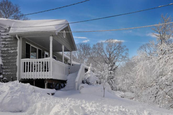 house engulfed in snow Toyota Prius Proves Its Worth In Power Outage