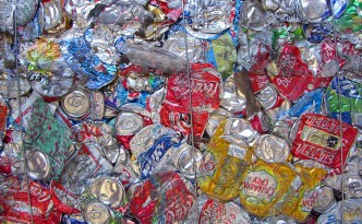 Nope, no recycled aluminum cans in the Tesla Motors mass-market vehicle.