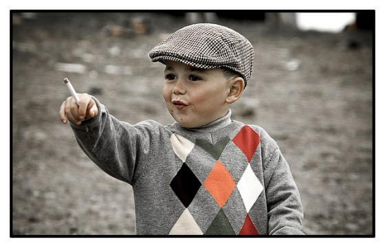 Child holding cigarette