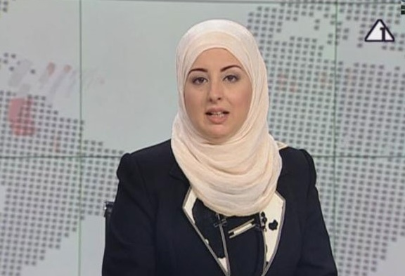 Hijab Moves From Sports, to a News Room, to a Green Debate
