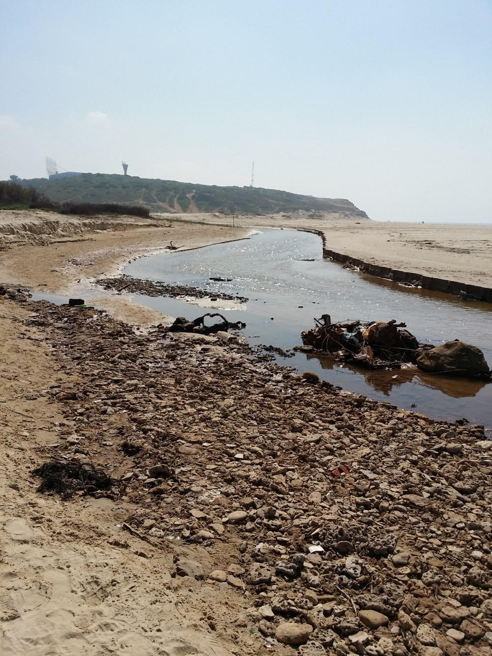 Heavily polluted Israeli stream cuts beach in half