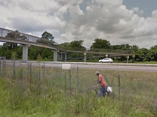 Bicylist crossing Juanita M. White Crosswalk from Stellars Jay Road on Google Maps Street View