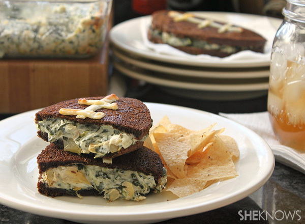 Football-shaped grilled cheese sandwiches stuffed with spinach artichoke dip