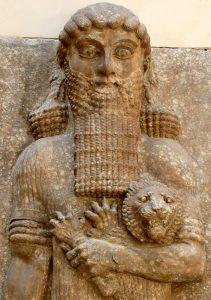 Gilgamesh holds lion