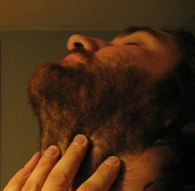 A man itching his beard