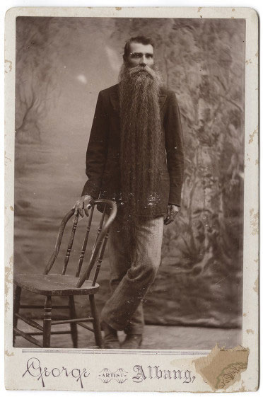 Photo of as man with a long beard.