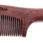 Photo of a wooden beard comb made from purpleheart.