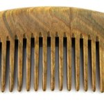Image of a pocket sized wooden beard comb.
