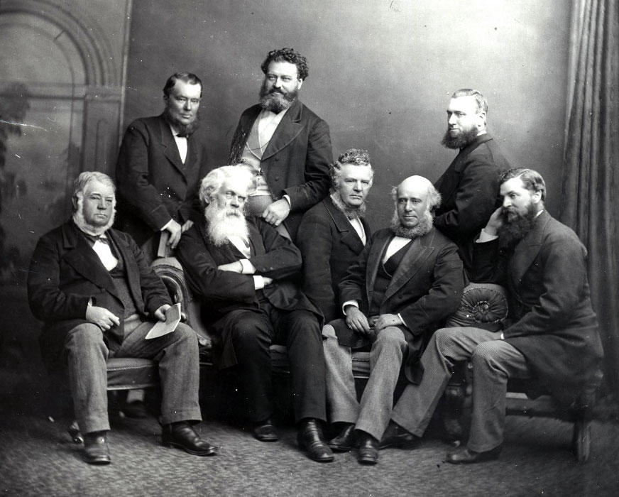 A photo of a group of bearded men.