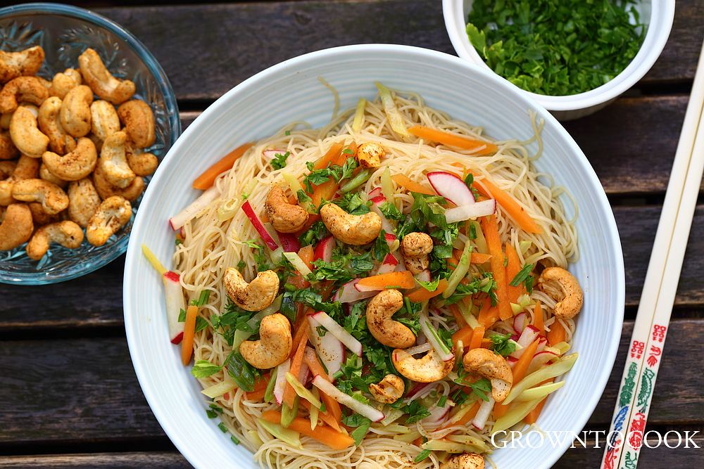 Chinese noodle salad with citrus, snow peas and spicy cashews