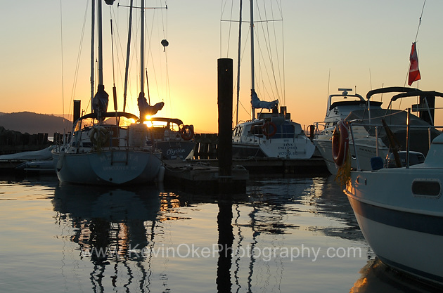 Sunset and sailboats at Thieves Bay Marina, North Pender Island