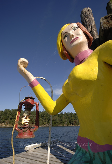 Monique, the wooden hitchhiker, greets boaters arriving at Page's Resort & Marina in Silva Bay, Gabriola Island.