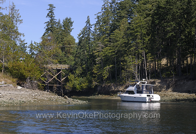 A pleasure boat approaching the Pender canal bridge from the Bedwell Harbour side. The Pender Canal separates North and South Pender Island and connects Bedwell Harbour with Port Browning. The canal was first dredged in 1902 with the bridge added in 1955.