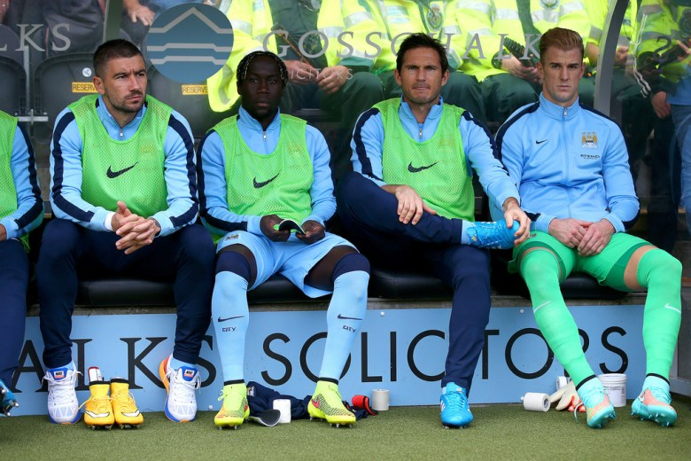 Sagna warms up City's bench.