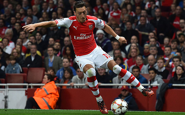 Ozil bewitches Stoke
