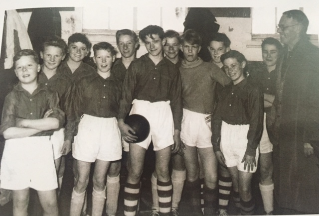 A young Peter Storey holding the ball, as captain of Aldershot and Farnborough Schools Under-13's