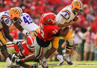 LSU QB Zach Mettenberger gets taken down by a GA defender (Daniel Shirey / USA TODAY Sports)