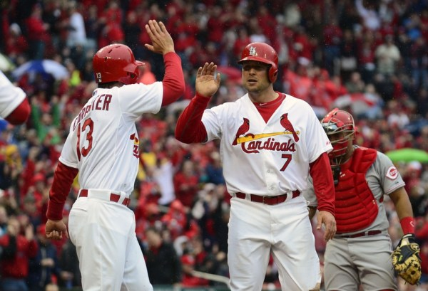Apr 7, 2014; St. Louis, MO, USA; St. Louis Cardinals left fielder Matt Holliday (7) is congratulated by third baseman Matt Carpenter (13) after scoring on a three run double by catcher Yadier Molina (not pictured) during the first inning against the Cincinnati Reds at Busch Stadium. Mandatory Credit: Jeff Curry-USA TODAY Sports
