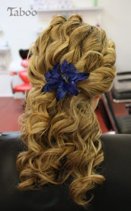 Updo hair design on long blonde hair with blue flower photo