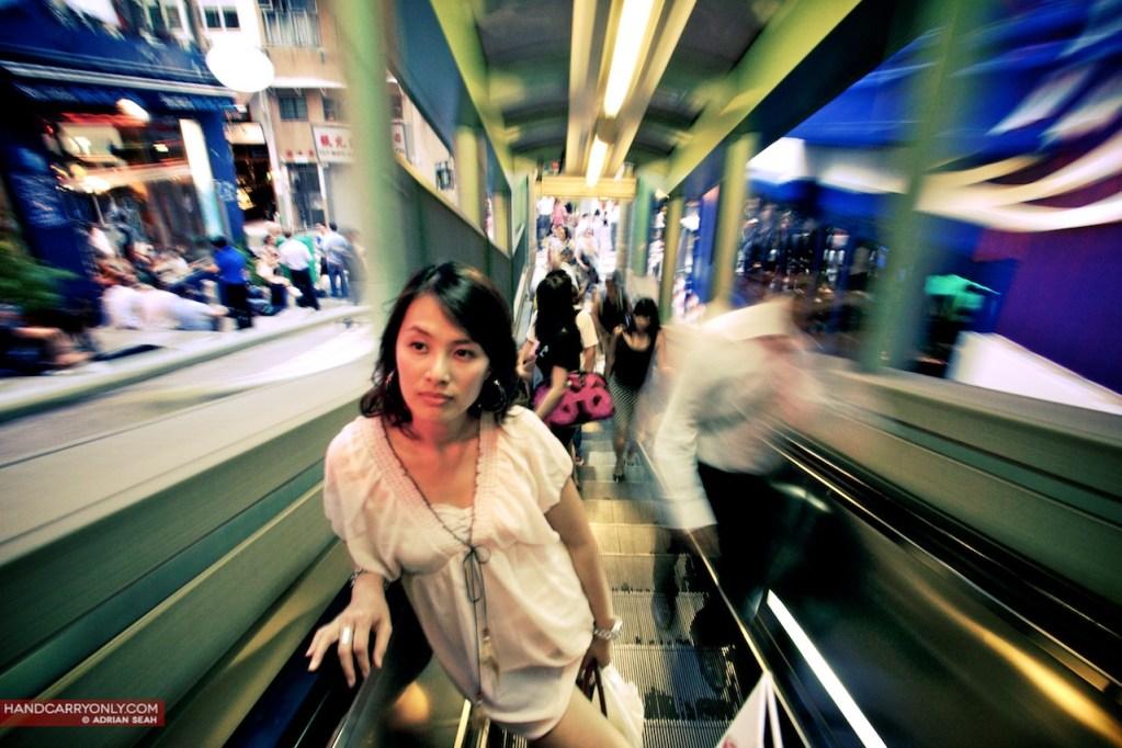 Girl on the mid levels escalator