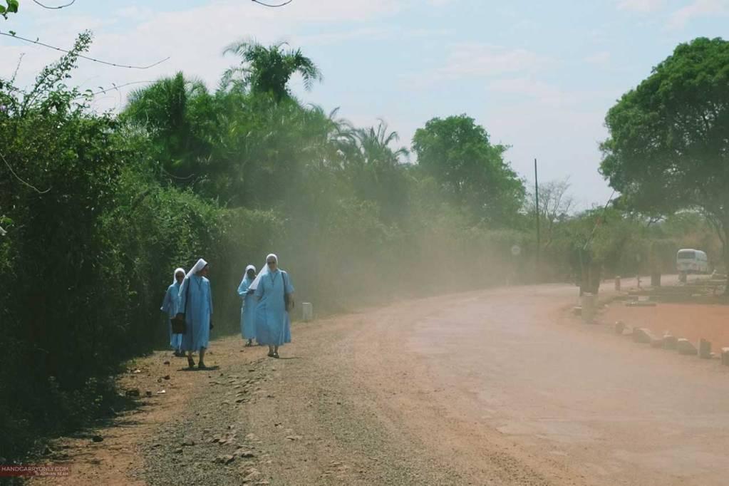 nuns on a dusty road in zambia